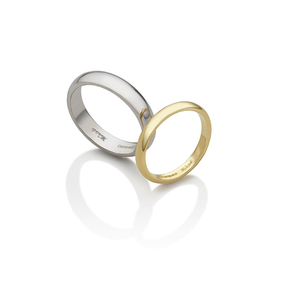 Wartski 'D' shaped wedding rings, eighteen carat yellow gold and platinum